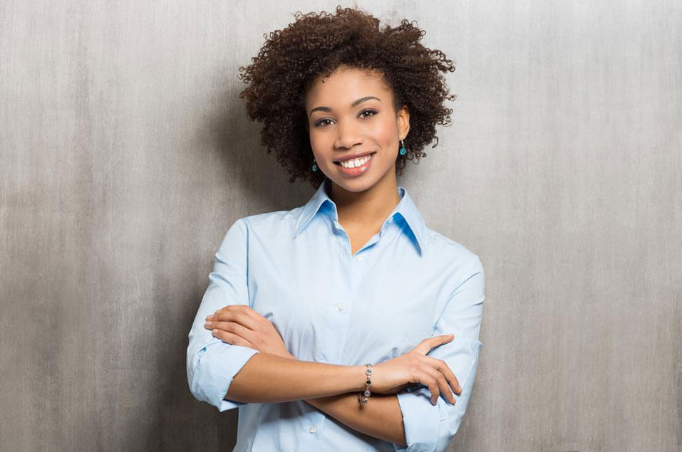 Woman crossing arms in a blue shirt