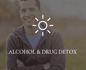"""A young guy wearing a jacket is smiling into the camera with """"ALCOHOL & DRUG DETOX"""" written overtop of the photo."""
