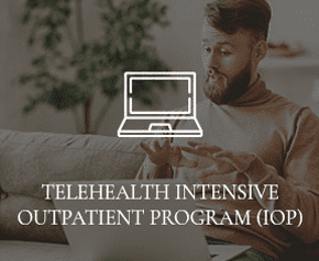 """A man is speaking into his computer, with the words """"TELEHEALTH INTENSIVE OUTPATIENT PROGRAM"""" overtop of the photo."""
